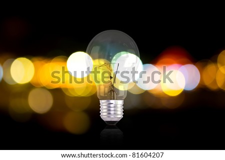 Electric light bulbs and lights out of focus - stock photo