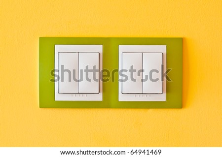 electric light switch on the wall - stock photo