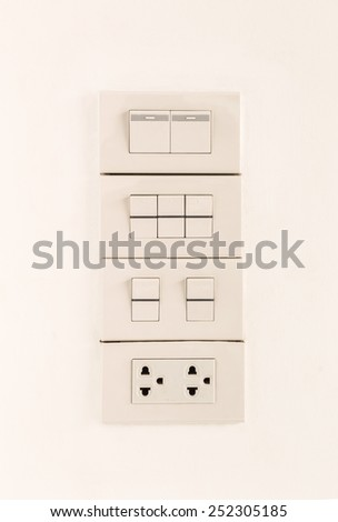 Electric light switches or switchboard and sockets on wall background, turn off position - stock photo