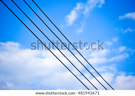 Electric line with blue sky in bright day as background.