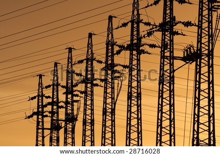Electric lines at a substation against evening sky - stock photo