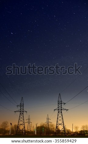 Electric main against the starry sky  - stock photo