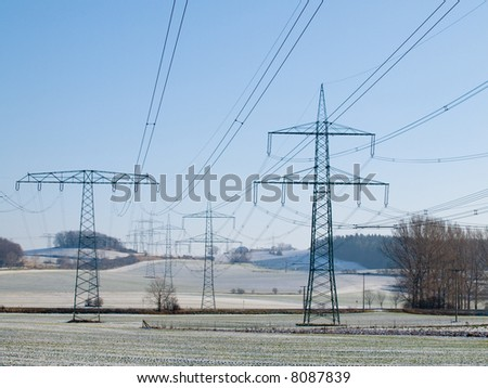 Electric main on a spring field with the pure dark blue sky
