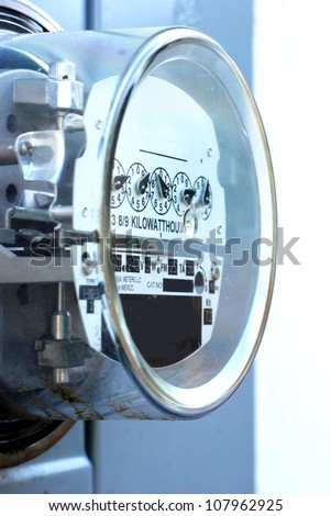 Electric meter, closeup, on outside wall - stock photo