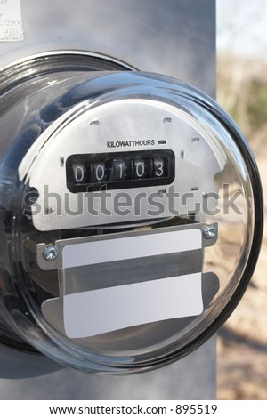 Electric meter on temporary pole at new construction - stock photo