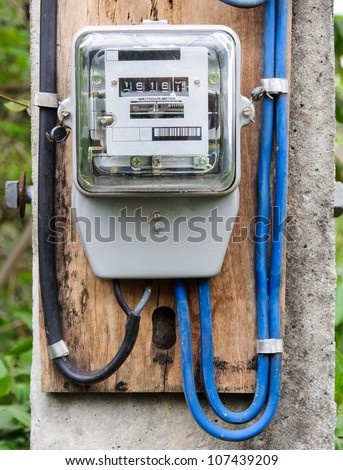 Electric meter on the power pole in countryside of Thailand - stock photo