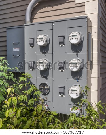 electric meters on the side of a small mall - stock photo