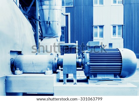 Electric motor in factory toned  blue tone - stock photo