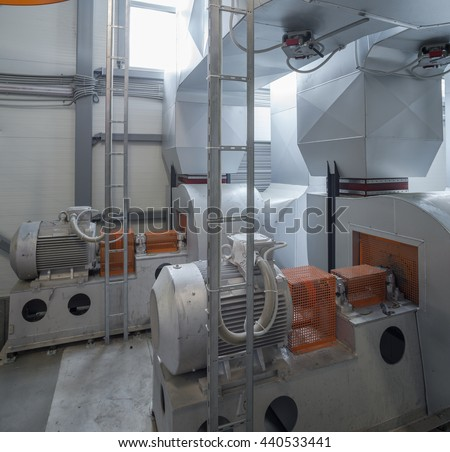 Electric motors drive the air pump. Boiler room.