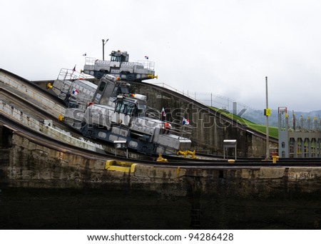Electric mules hlp ships through the Panama Canal - stock photo