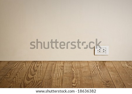 electric outlet in a wall in an old house interior - stock photo