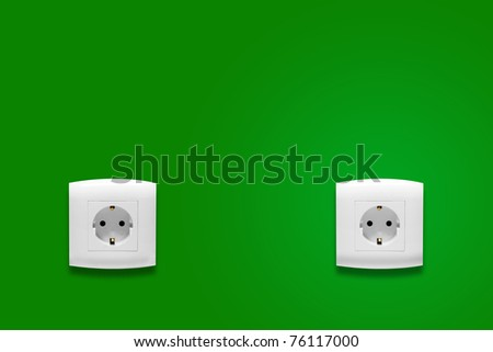 Electric outlet on green wall - stock photo