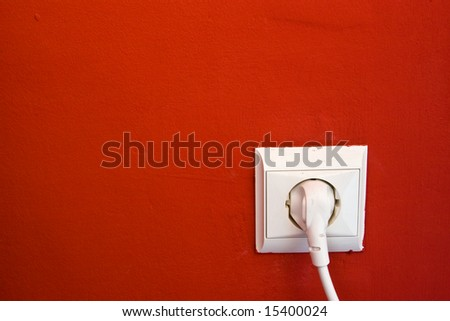 electric outlet on red wall - stock photo
