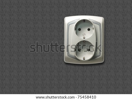 Electric outlet with gray wall background - stock photo