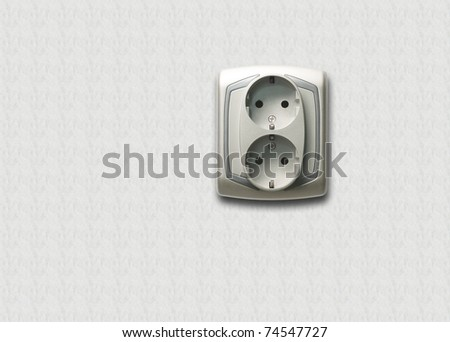 Electric outlet with white wall background
