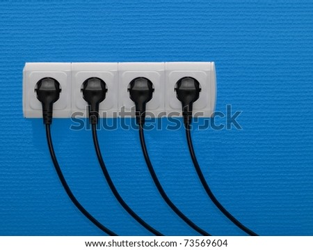 Electric outlets with cables connected - stock photo