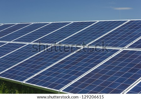 Electric photovoltaic solar panels cells on a field. - stock photo