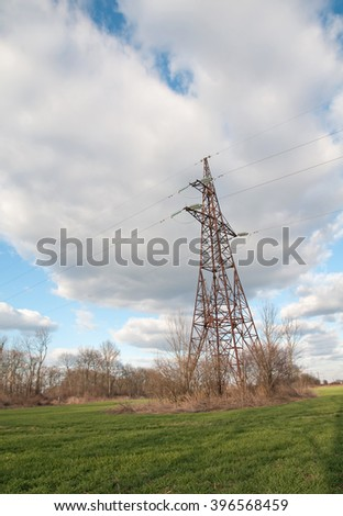 electric pillar of green wheat field - stock photo