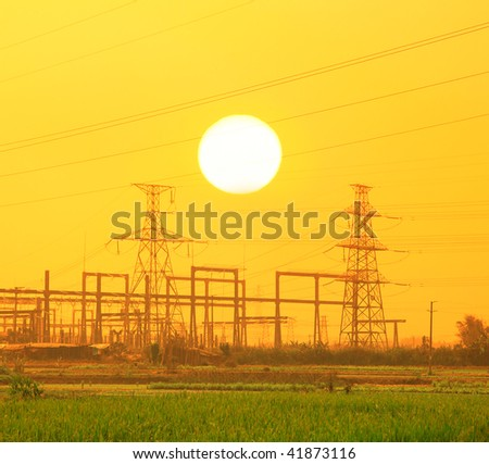 Electric pillar over blue sky in sunset