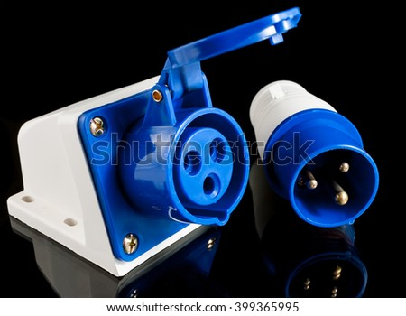 Electric plastic power plug and wall socket with cap isolated on black background - stock photo