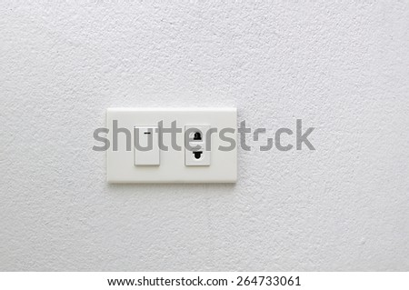 electric plug and switch on wall - stock photo