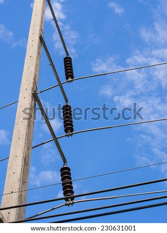 Electric pole and wires and couldy sky.