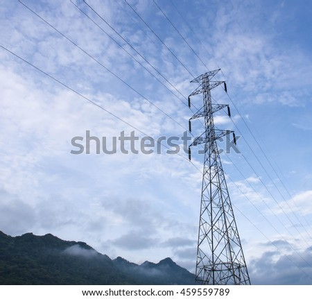 Electric pole connect to the high voltage electric wires on sky background.