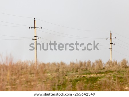 electric pole in nature - stock photo