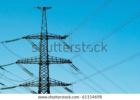 Electric pole on a background of blue sky