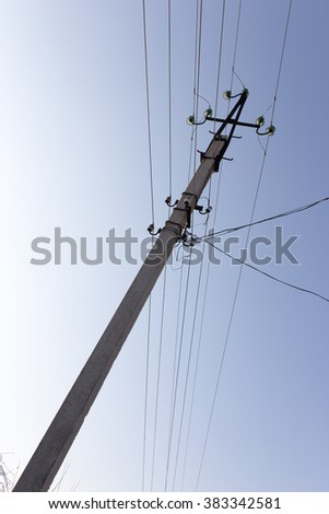 electric pole on the background of blue sky