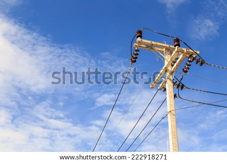 Electric pole power lines and wires with blue sky background - stock photo