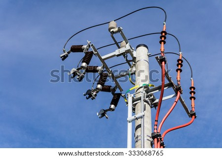 Electric pole under construction with blue sky in background. Horizontal image