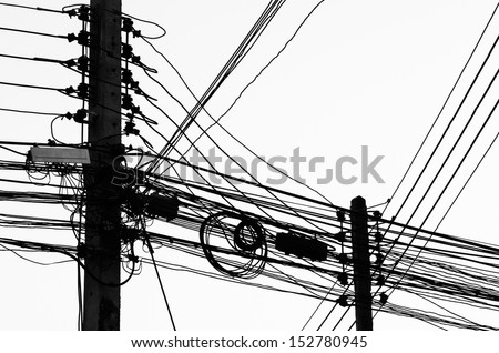 Electric pole with a many cables  in black and white - stock photo