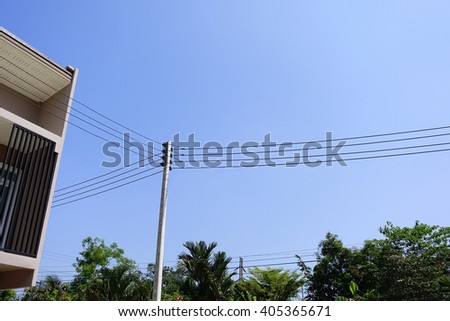 Electric pole with electric line on building and ,sky background:select focus with shallow depth of field. - stock photo
