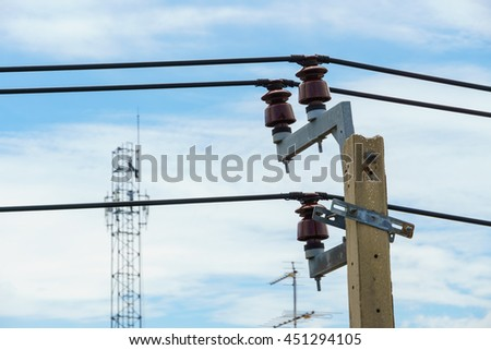 Electric pole with electric line on sky background