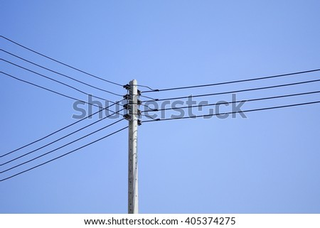 Electric pole with electric line on sky background:select focus with shallow depth of field. - stock photo