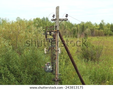 Electric pole with old transformers - stock photo