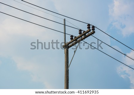 Electric pole with sky and clouds - stock photo