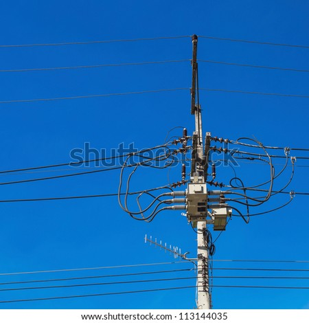 electric pole with wires on a background of blue sky - stock photo