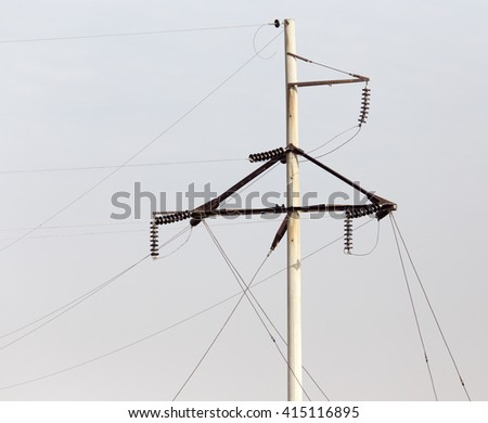 electric poles in nature - stock photo