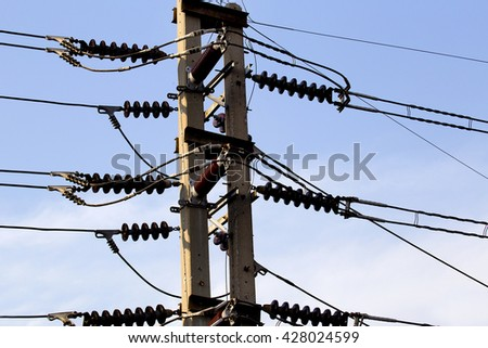Electric Post , Abstract view of power lines and pylon against vivid blue sky.