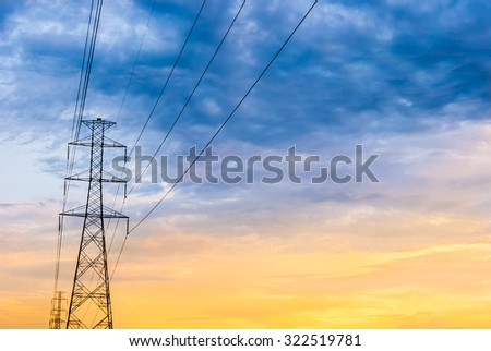 Electric post with cloudy sky on blue and yellow background