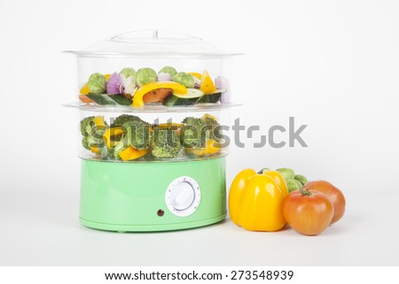electric pot for cooking vegetables on white background - stock photo