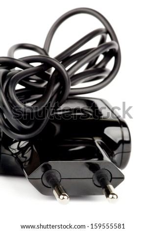 Electric Power Adapter with Curled Cable and Plug isolated on white background