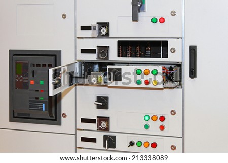 Electric power control in rack cabinet - stock photo