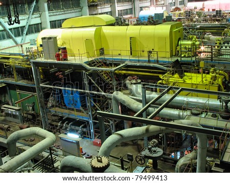Electric power generator at a power plant, night scene - stock photo