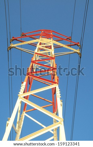 Electric Power Line Pylon over a colored Sunset