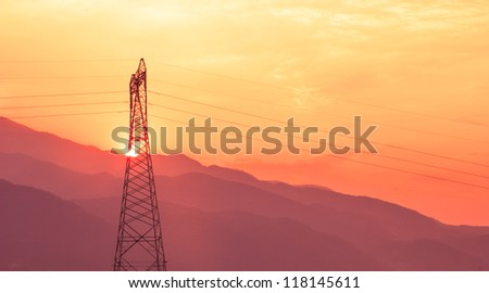 Electric Power lines at Sunset mountain view - stock photo
