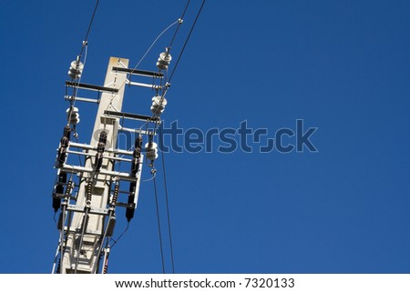 Electric power lines over clear blue sky
