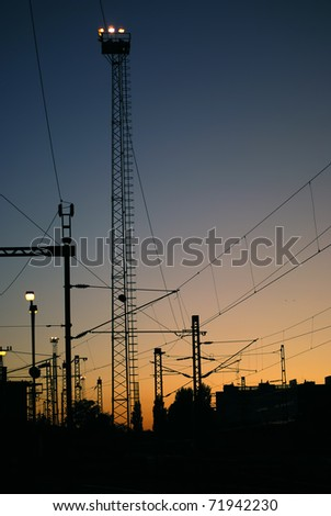 Electric power lines silhouette - stock photo